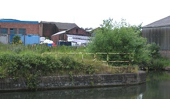 a view of the site from the canal on the right is what remains of commercial wharf